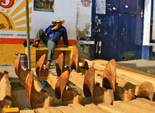 Plow Maker, Tlacolula market, Mexico. Mexican plow maker sells his handcrafted work at market. Tlacolula, Oaxaca Royalty Free Stock Photography