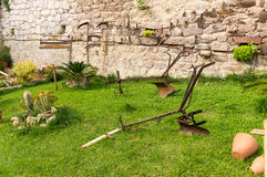 Plow and old gardening tools Stock Image
