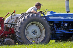 Plow plough concentrate line. Troy Gray concentrates on his line at the 2010 New Brunswick Provincial Plowing Match and Canadian Plowing Championships on August Royalty Free Stock Images