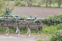 Plow for plowing soil. Plow on trailer for tractor. royalty free stock photos