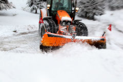 Plow removing snow from city street Royalty Free Stock Images
