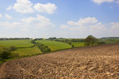 Plow soil and patchwork fields in springtime Stock Image