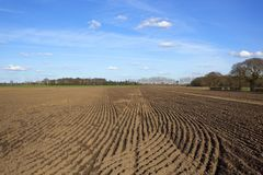 Plow soil patterns in springtime Royalty Free Stock Images