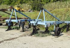 Plow on trailer for tractor. Plow for plowing soil. Trailer Hitch for tractors and combines. Trailers for agricultural machinery Royalty Free Stock Images