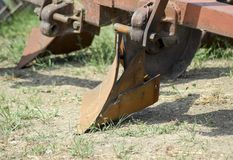 Plow on trailer for tractor. Plow for plowing soil. Trailer Hitch for tractors and combines. Trailers for agricultural machinery Royalty Free Stock Photos