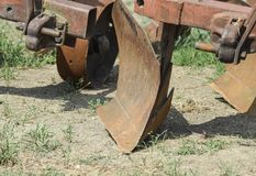 Plow on trailer for tractor. Plow for plowing soil. Trailer Hitch for tractors and combines. Trailers for agricultural machinery Stock Photos