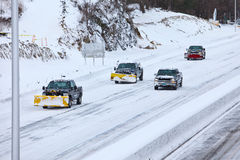 Plow trucks on highway after storm 2013 Stock Image