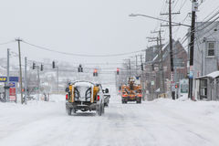 Plow trucks on street after storm 2015 Royalty Free Stock Image