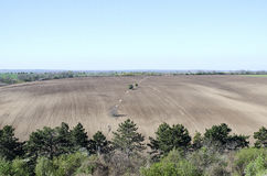Plowed agricultural field. Is summer season Royalty Free Stock Photos