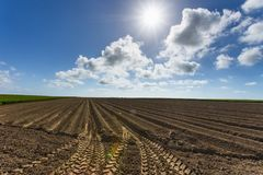 Plowed agricultural fields in Normandy, France. Countryside landscape. Environment friendly farming and industrial Stock Image