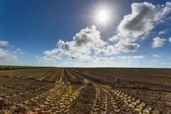 Plowed agricultural fields in Normandy, France. Countryside landscape. Environment friendly farming and industrial Royalty Free Stock Photos