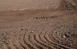 Plowed agriculture field, brown soil stock image