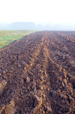 Plowed autumn farm field and mist Royalty Free Stock Photos