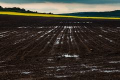Plowed black earth horizontal landscape royalty free stock images