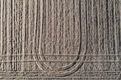 Plowed earthy field, dirt background. Countryside, farming and agriculture. Landscape stock image