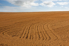 Plowed empty agriculture hill field Royalty Free Stock Image