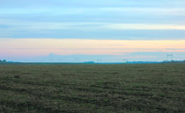 Plowed fertile field with chernozem in the morning Royalty Free Stock Photography