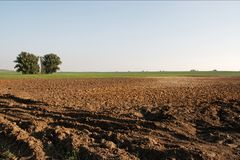Plowed field. Plowed soil on big field in the countryside Royalty Free Stock Images