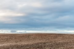 Plowed Field And Cloudy Sky Royalty Free Stock Photos