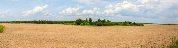 The plowed field. Arable. The agricultural work. Soil, bare ground. A panoramic photo royalty free stock images