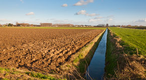 Plowed field in autumnal sunlight Stock Image