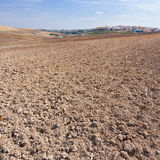 Plowed Field. On the Background of the Small Spanish City Stock Image