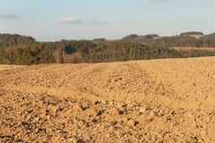 Plowed field in the countryside in Czech Republic. The spring works in the field. Farmland. Stock Photography