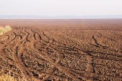 Plowed field at dawn. Field prepared for the winter period, Russia, Krasnodar region Royalty Free Stock Photos