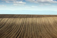 Plowed field farmland landscape Stock Photos