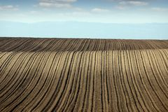 Plowed field farmland landscape spring season Stock Image