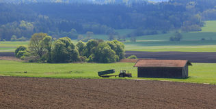 Plowed field and greenery, agricultural scenery Stock Photos