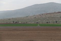 Plowed Field with Lines of Soil Stock Images