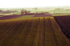 Plowed field at morning Stock Photos