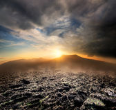 Plowed field in the mountains Stock Images