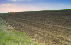 Plowed field ready for sowing with blue sky with clouds Royalty Free Stock Photo