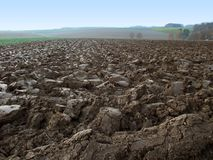Plowed field in rural ambiance Royalty Free Stock Photo