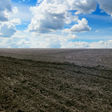 Plowed field and  sky Stock Photos