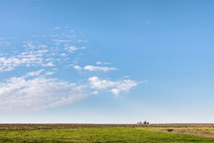 Plowed field in spring and clouds over it.  Royalty Free Stock Image