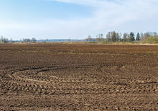 Plowed field in spring. Stock Photos