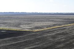 Plowed field in the spring in the village. Agricultural land in the Kuban. Preparation of fields for sowing wheat. stock photography