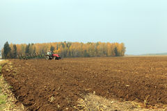 Plowed field  by a tractor Stock Images