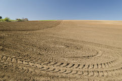 Plowed field with tractor traces Stock Photo