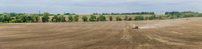 Plowed field with tractors Royalty Free Stock Images