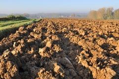 Plowed field under sun. Landscape of freshly plowed field under  autumn sun Royalty Free Stock Photography