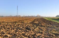 Plowed field under sun. Landscape of freshly plowed field under  autumn sun Stock Images