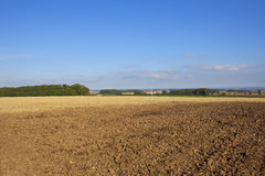 Plowed field with wind turbine Stock Photo