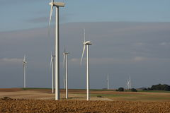 Plowed field and  Windmill Royalty Free Stock Photos