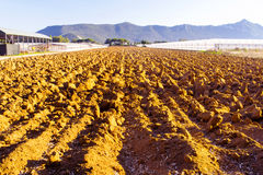 Plowed fields and green house Royalty Free Stock Images