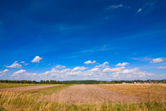 Plowed fields and sky Stock Photography