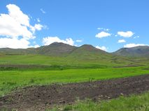Plowed and green fields at Avoca valley of Southern Drakensberg Stock Images